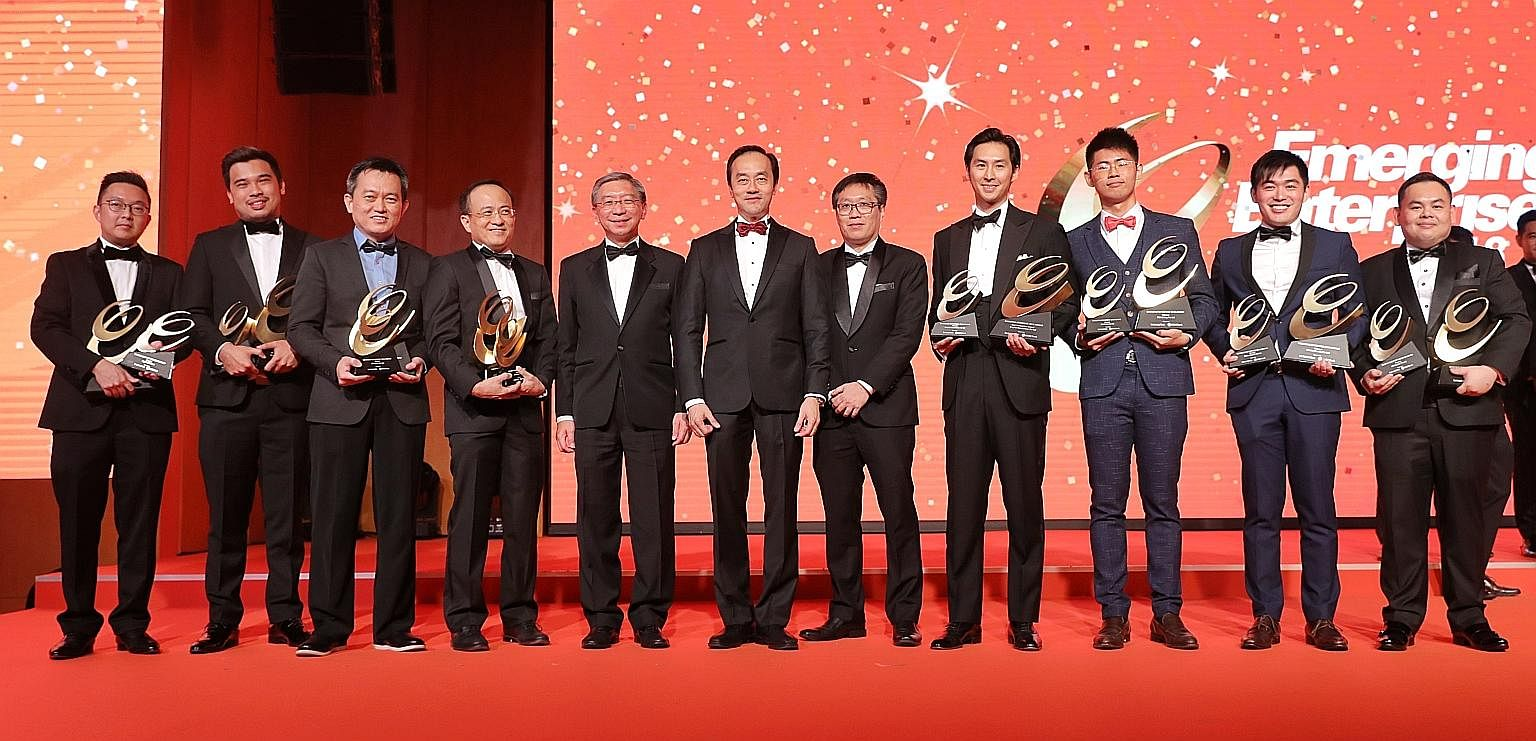 At the Emerging Enterprise Award event last night were (from left) Big Tiny co-founder Adrian Chia, Mighty Jaxx founder Jackson Aw, Whizpace founder and CEO Oh Ser Wah, EndoMaster CEO Goh Seow Ping, OCBC head of global commercial banking Linus Goh, S