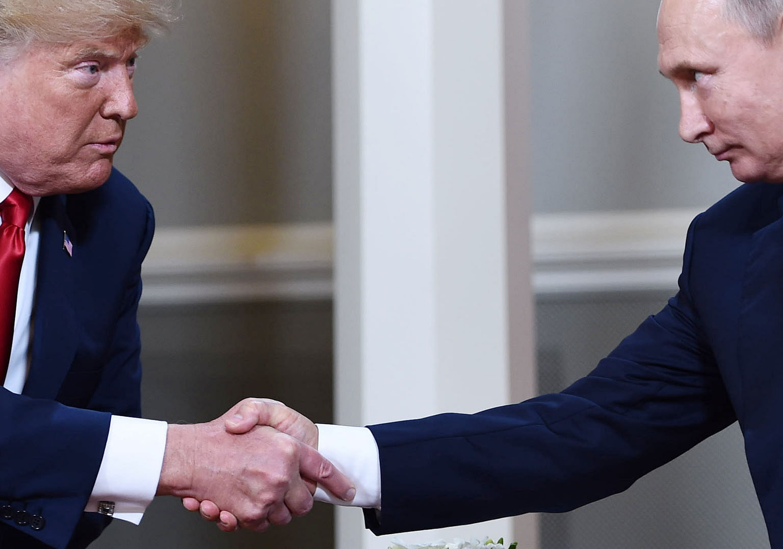 US President Donald Trump (far left) and Russian President Vladimir Putin at the Helsinki summit in July. Russian operators were accused of manipulating social media to disseminate disinformation during the 2016 US presidential election, which Mr Tru