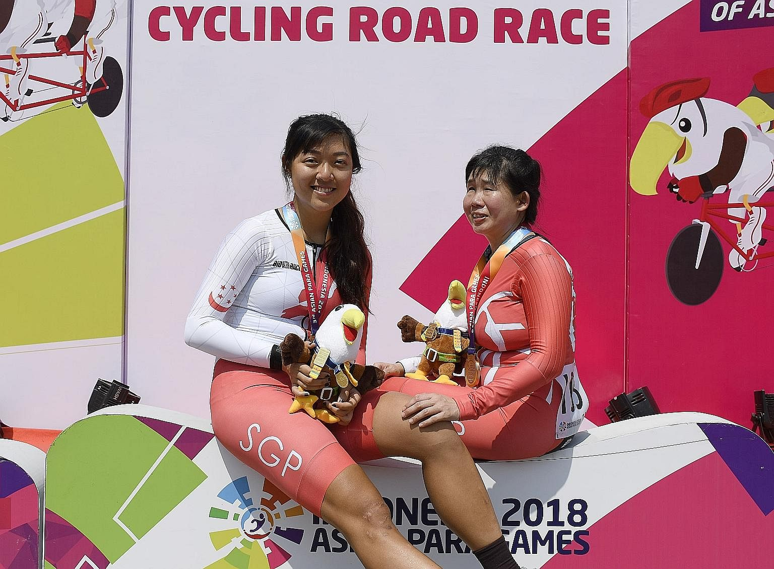 Pilot Sarah Tan and cyclist Emily Lee (far right) finished third yesterday in the Asian Para Games women's 72km road race B. They clinched Singapore's first cycling medal in the Jakarta Games. The Republic won three other medals yesterday through swi