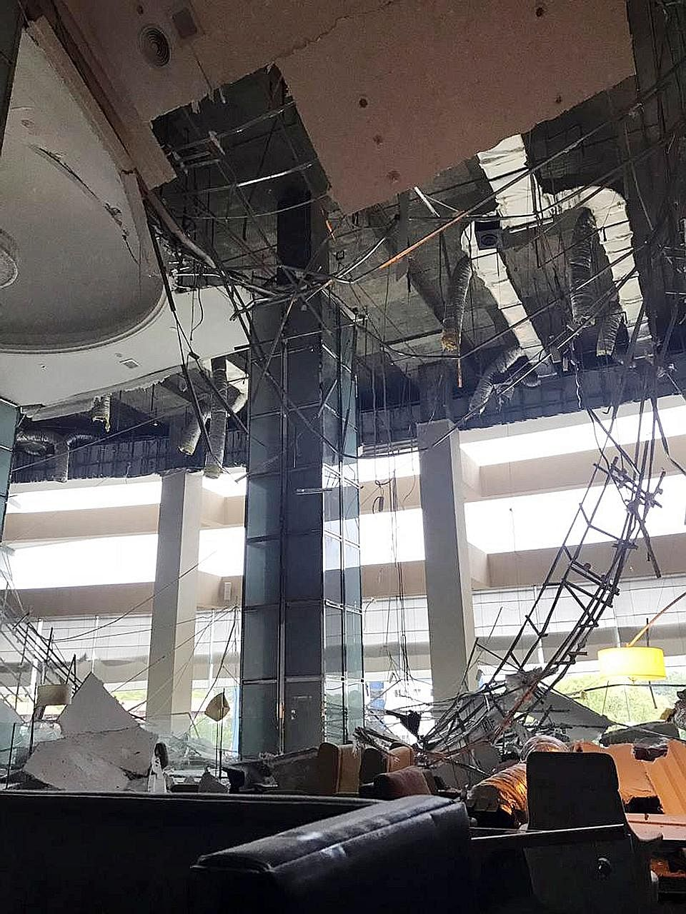 A worker (above) fell 12m and suffered head injuries after the plaster ceiling (right) collapsed during routine maintenance.