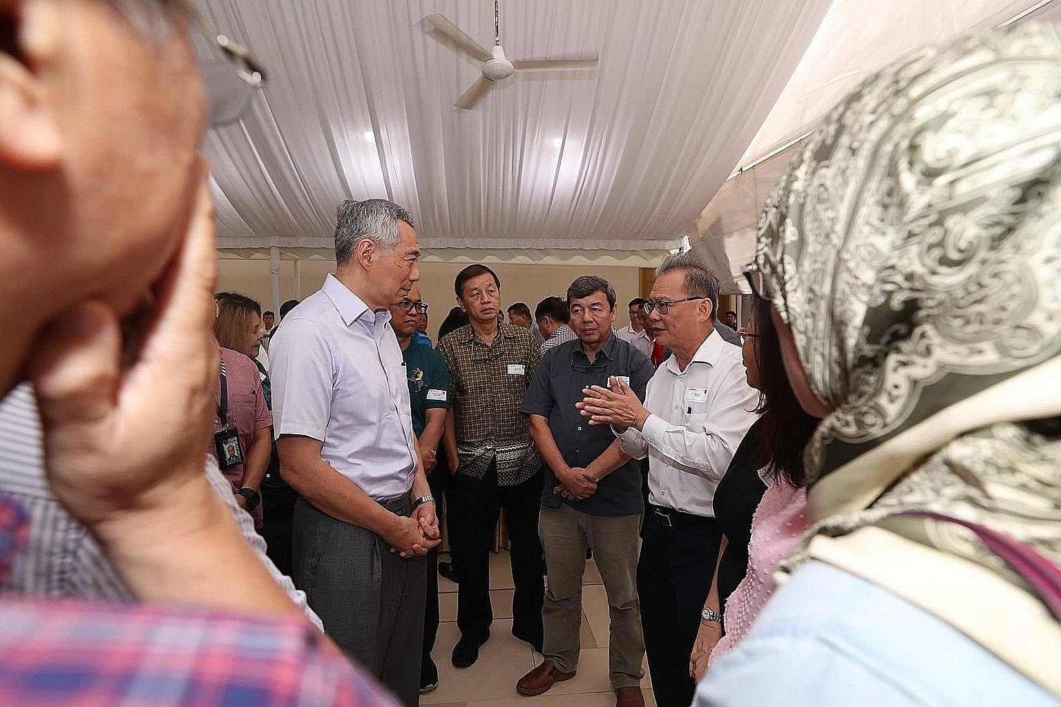 Prime Minister Lee Hsien Loong speaking to attendees of a closed-door post-National Day Rally dialogue organised by the People's Association on Oct 14, at a reception after the event.