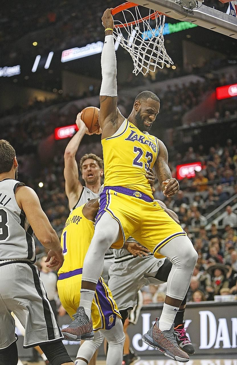 LeBron James hanging onto the rim after a turnover at San Antonio Spurs on Saturday but the Los Angeles Lakers star sees positives from the game and believes his team will grow and get better.