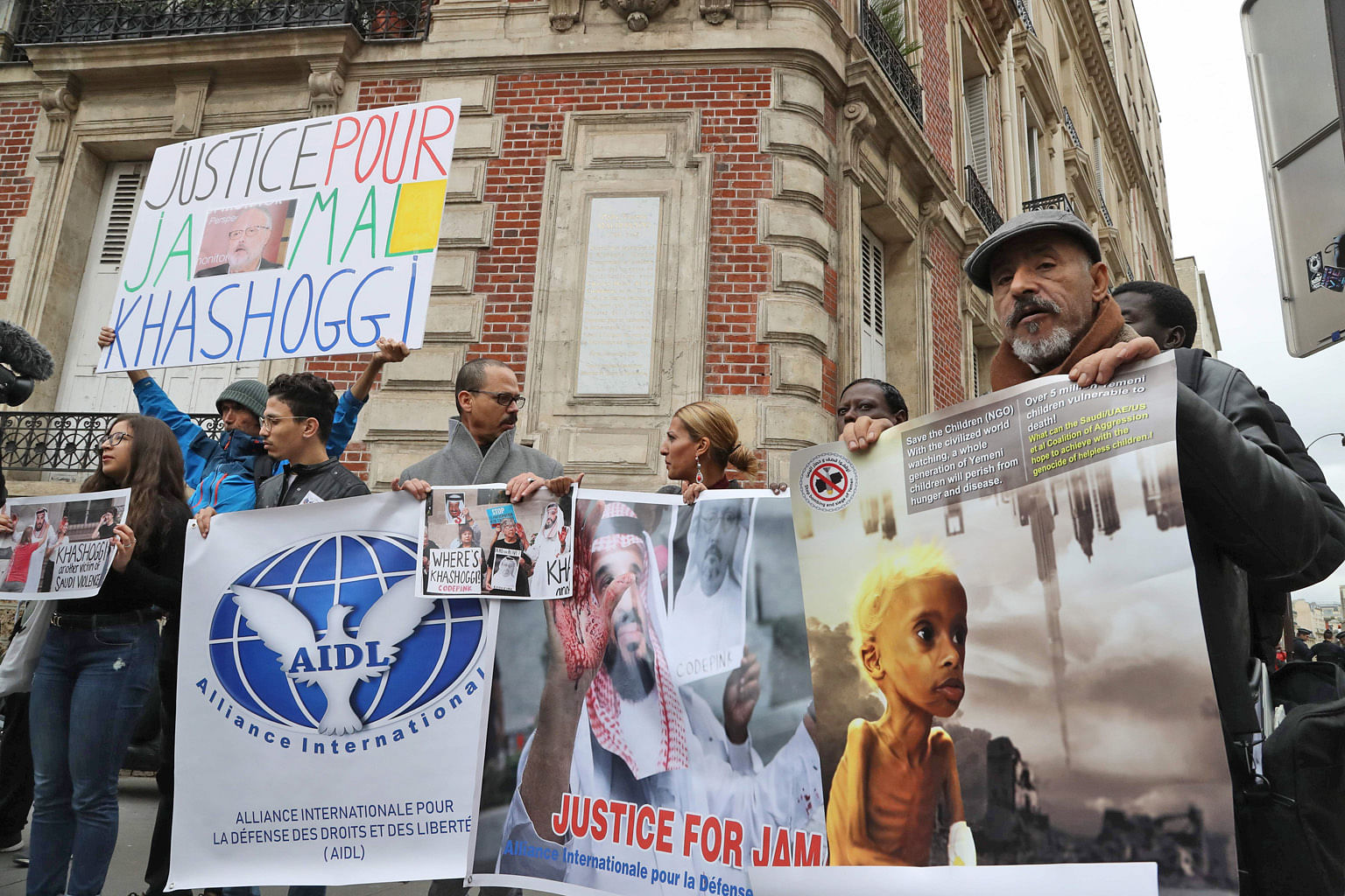 Protesters holding placards outside the Saudi Arabian Embassy in Paris last week demanding justice for Washington Post journalist Jamal Khashoggi, after the Saudi Arabian national was murdered last month in his country's consulate in Istanbul, Turkey