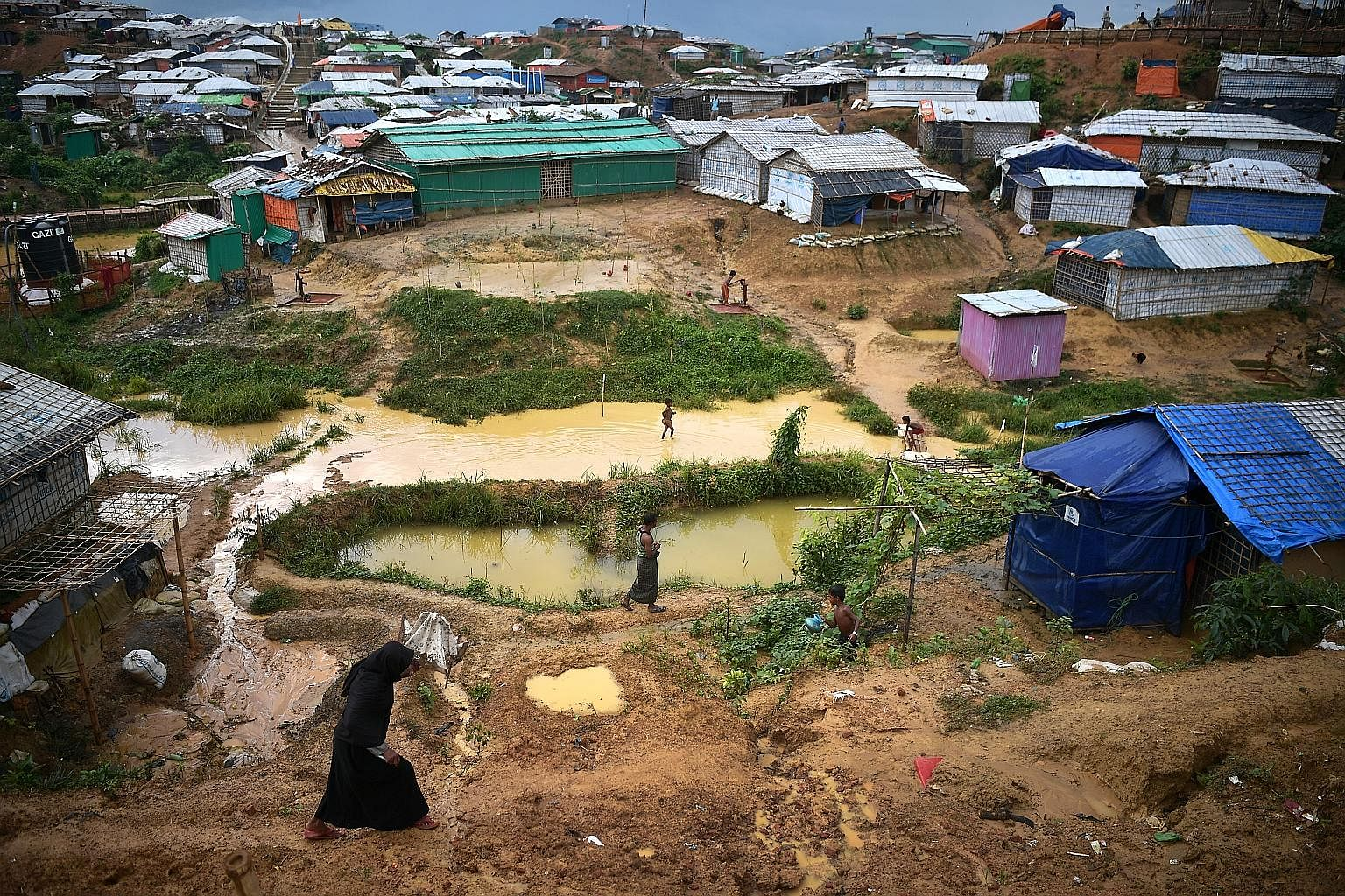 The ST team spent nine days in Bangladesh to curate a first-hand account of the daily existence of the Rohingya refugees in camps there. Rohingya refugees at the Kutupalong mega camp in Bangladesh's Cox's Bazar district in July. About 919,000 Rohingy