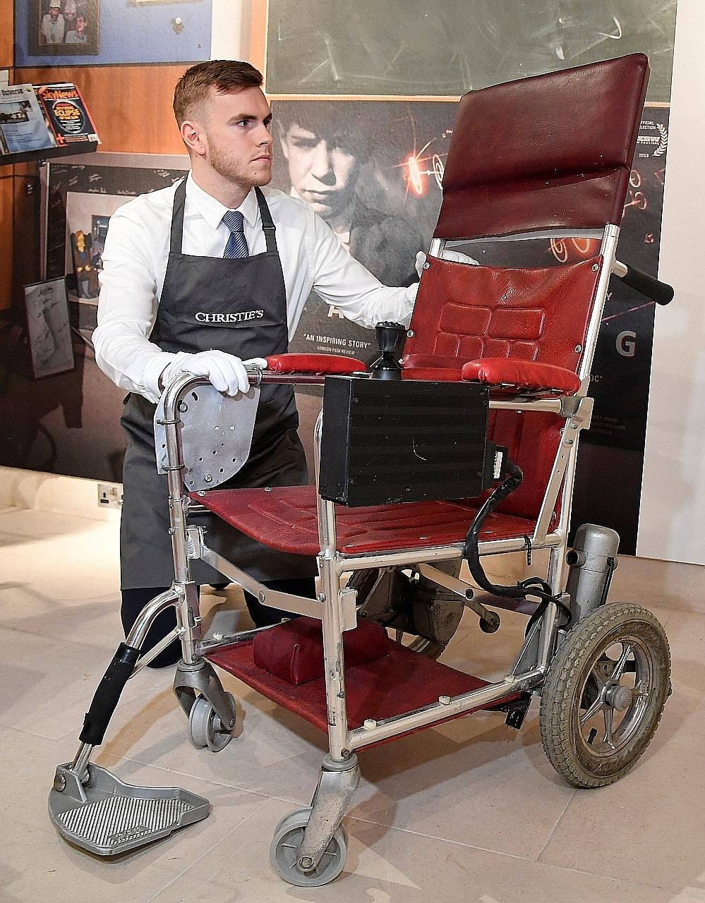 This motorised wheelchair used by British physicist Stephen Hawking, who died in March at the age of 76, was sold at auction for £296,750 (S$532,100).