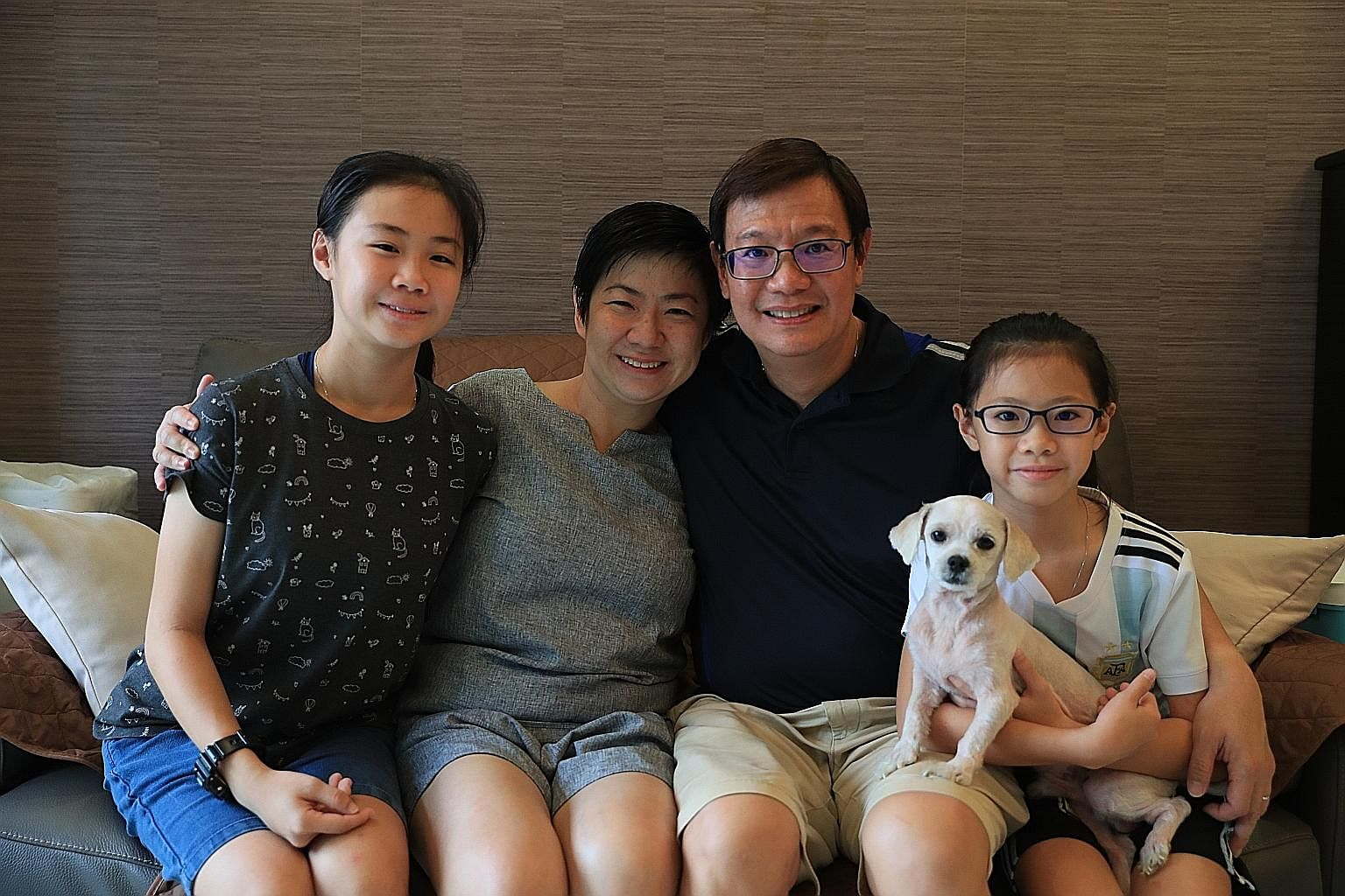 Ms Low relaxing at home with her husband Francis Tang and daughters Juliet (left) and Emily, and their family dog. Ms Low attending the Convention on the Rights of Persons with Disabilities at the UN headquarters in New York in 2015. She lost her hea