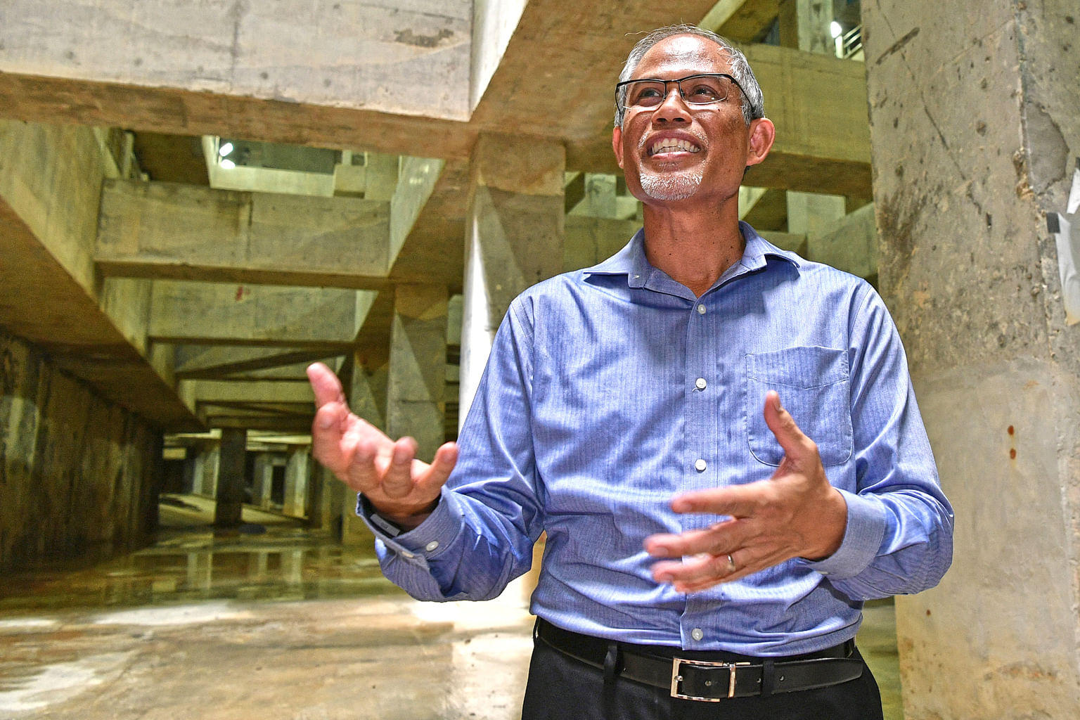 Mr Masagos Zulkifli (above) at the Stamford Detention Tank (left), which can hold up to 38,000 cubic m of storm water, an amount equivalent to 15 Olympic-sized swimming pools, on Friday.