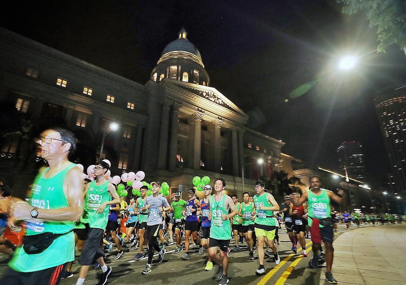 Runners made their way past the National Gallery yesterday as the city centre came alive at dawn with more than 30,000 enthusiasts pounding the streets during the Standard Chartered Singapore Marathon. The event, now into its 17th edition, attracted