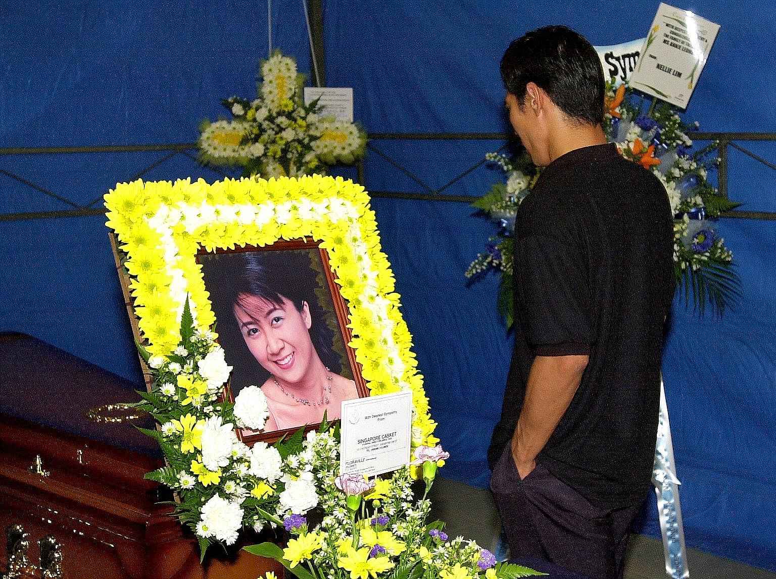 Ler at Ms Leong's wake. He was hanged in December 2002 for abetment of murder.