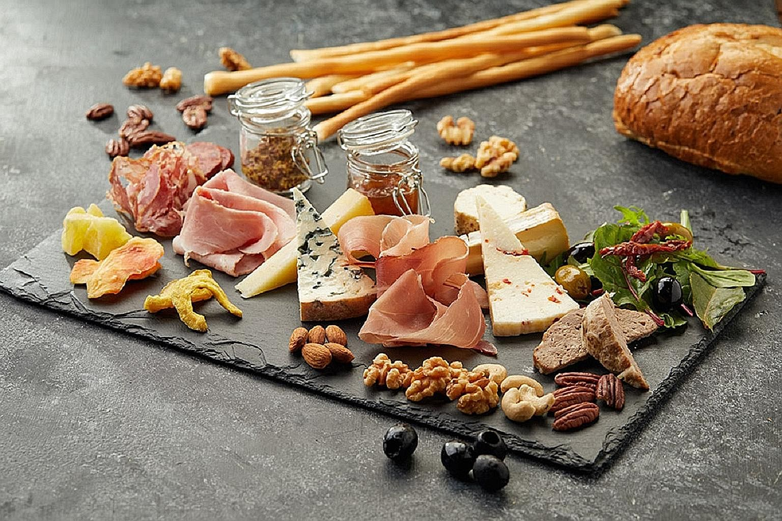 Nibble on Wine Connection's Cold Cut Platter, which includes cheese, bread and wine.
