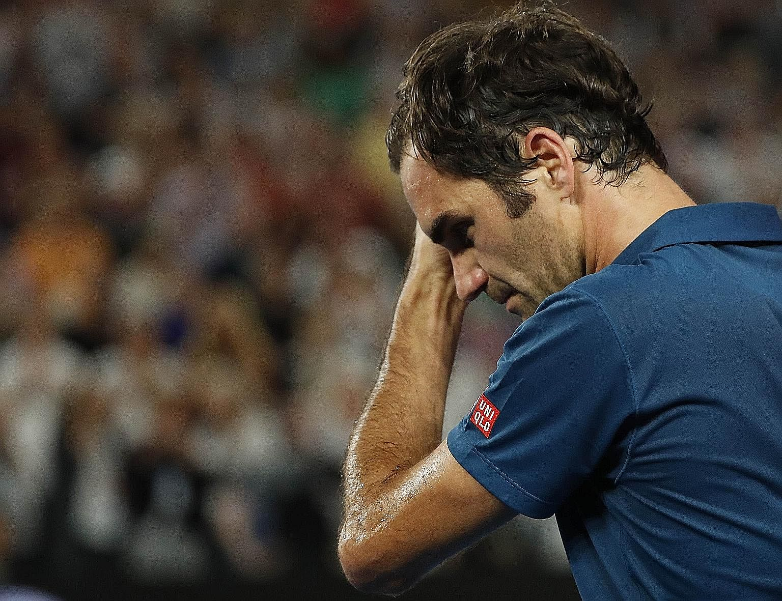 Greece's Stefanos Tsitsipas (left) in disbelief after his shock fourth-round win over defending champion Roger Federer at the Australian Open yesterday.