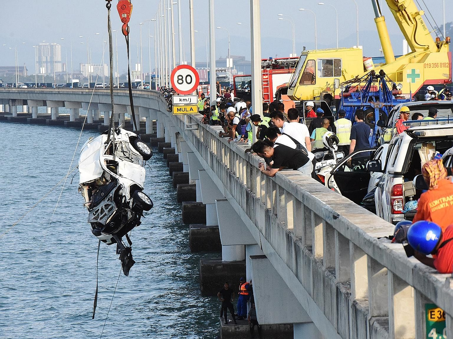 Malaysian rescuers yesterday retrieved the car that plunged into the sea on Sunday from the Penang Bridge, with the driver's body inside. The wrecked sport utility vehicle was hoisted out by a crane in a 20-minute operation. It had plunged into the s