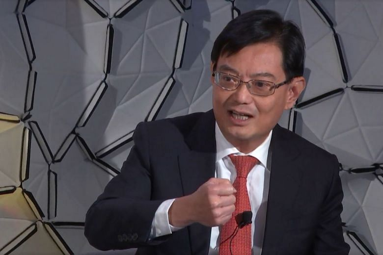 f815569ccc Mr Heng Swee Keat speaking at the World Economic Forum in Davos. PHOTO   WORLD ECONOMIC FORUM