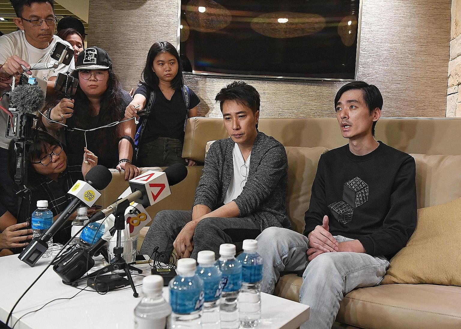 CFC Aloysius Pang was with two other personnel inside a howitzer when he was injured last Saturday. Singaporean actor Aloysius Pang's manager Dasmond Koh (left) and elder brother Kenny Pang speaking to the media at Changi Airport yesterday. Mr Koh sa