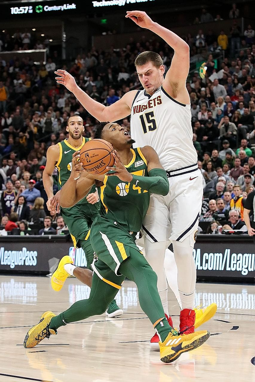 Denver's Nikola Jokic trying to stop Donovan Mitchell as the Nuggets lost 114-108 to hosts Utah Jazz on Wednesday to drop to 31-15. The Serbian centre leads the West's second-best team in points, assists and rebounds.