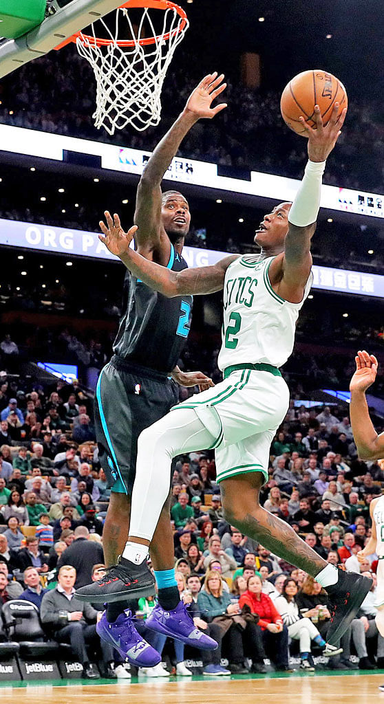 Boston's Terry Rozier (right) taking a shot against Charlotte's Marvin Williams during the second half at Boston's TD Garden home on Wednesday. Rozier scored 17 points to help his team to a 126-94 victory over the Hornets.