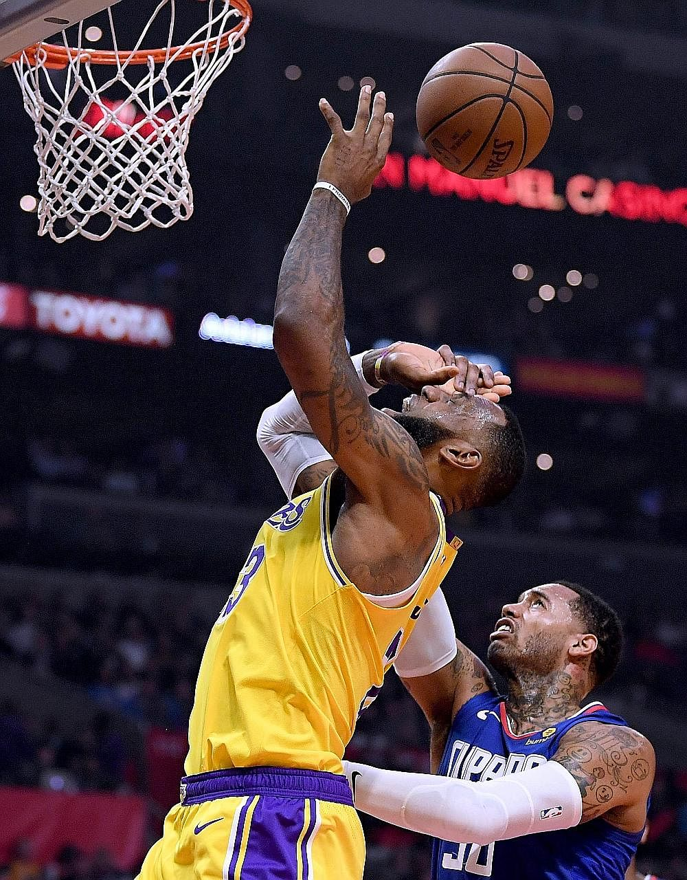 LeBron James being fouled by the Clippers' Mike Scott in the first half at Staples Centre on Thursday. The Los Angeles Lakers forward made a triumphant return after 36 days on the sidelines, leading his team to a 123-120 overtime win over the Clipper