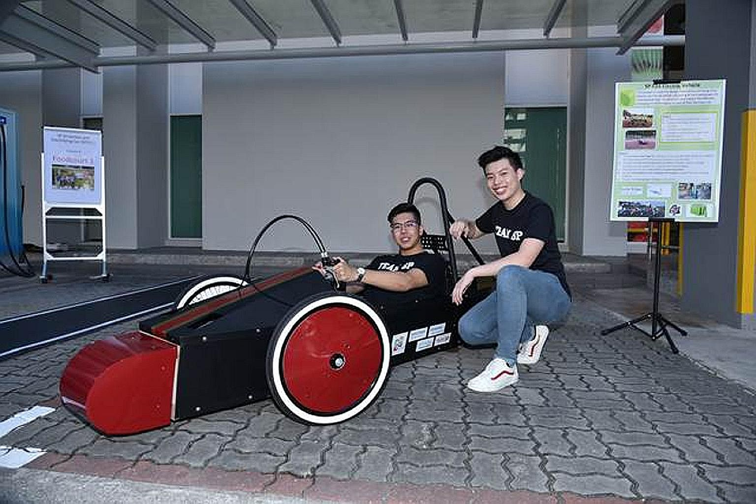 Singapore Polytechnic students showcasing their SP Driverless and Electrifying Car project at last month's launch of 5G Garage - a facility set up at the polytechnic by Singtel and Ericsson to test and develop 5G projects.
