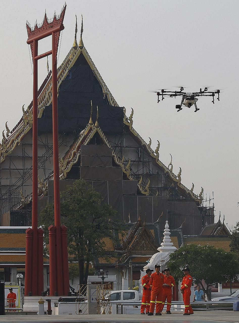 The Bangkok Metropolitan Administration is using drones to spray a water-based solution in the air to try and ease the effects of heavy smog.