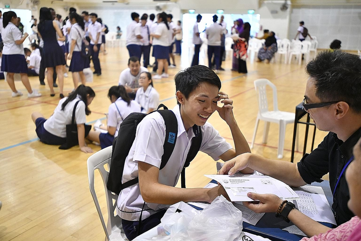 A student collecting his O-level exam results at Serangoon Garden Secondary School last month. On the issue of exam scripts, Education Minister Ong Ye Kung said that by the year end, marking for all GCE exams would be shifted online, so there should