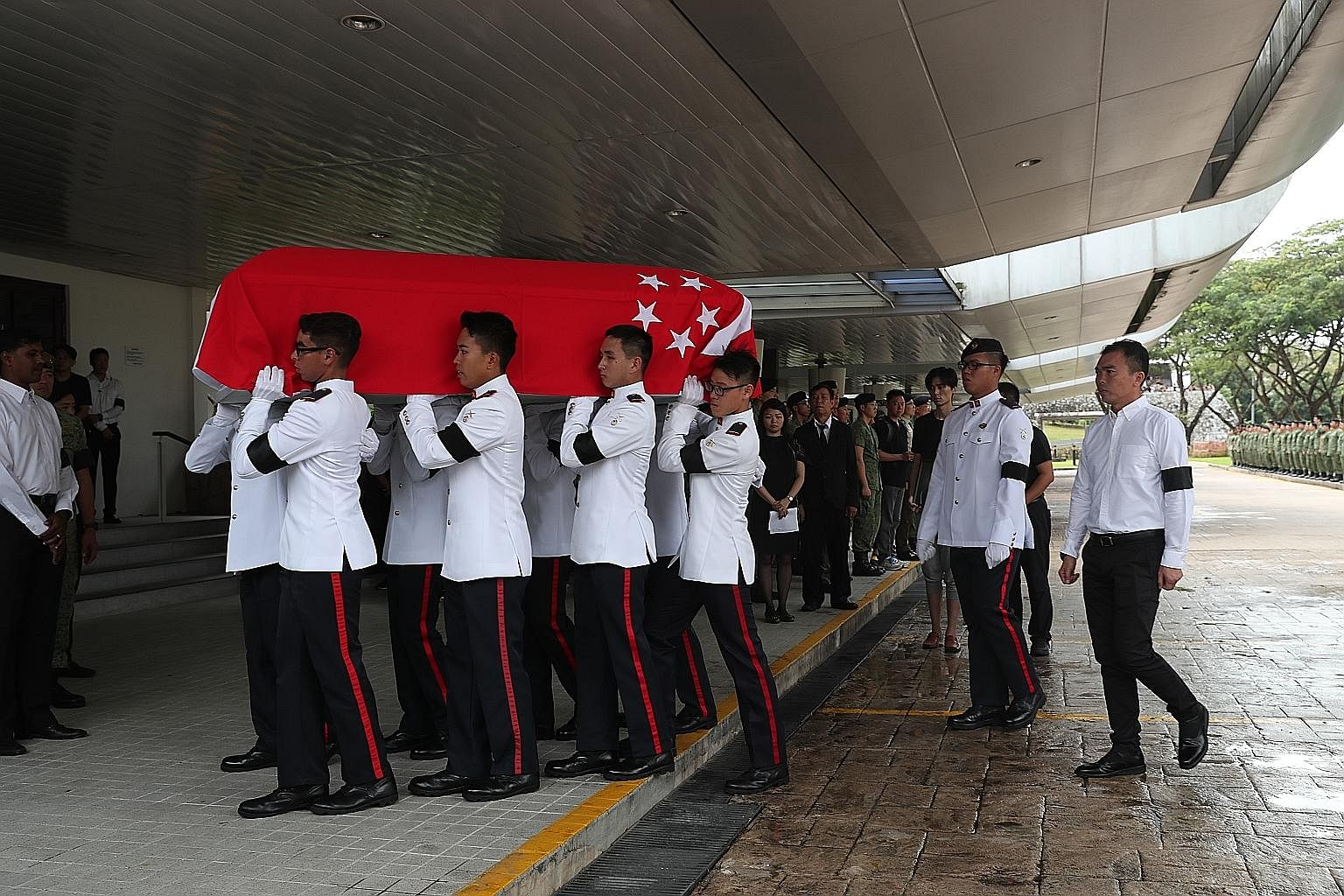 SAF personnel carrying the coffin of Corporal First Class Aloysius Pang (above) into Mandai Crematorium last month. Following the incident that led to CFC Pang's death, members of the public had suggested reducing the need for NSmen to perform mainte