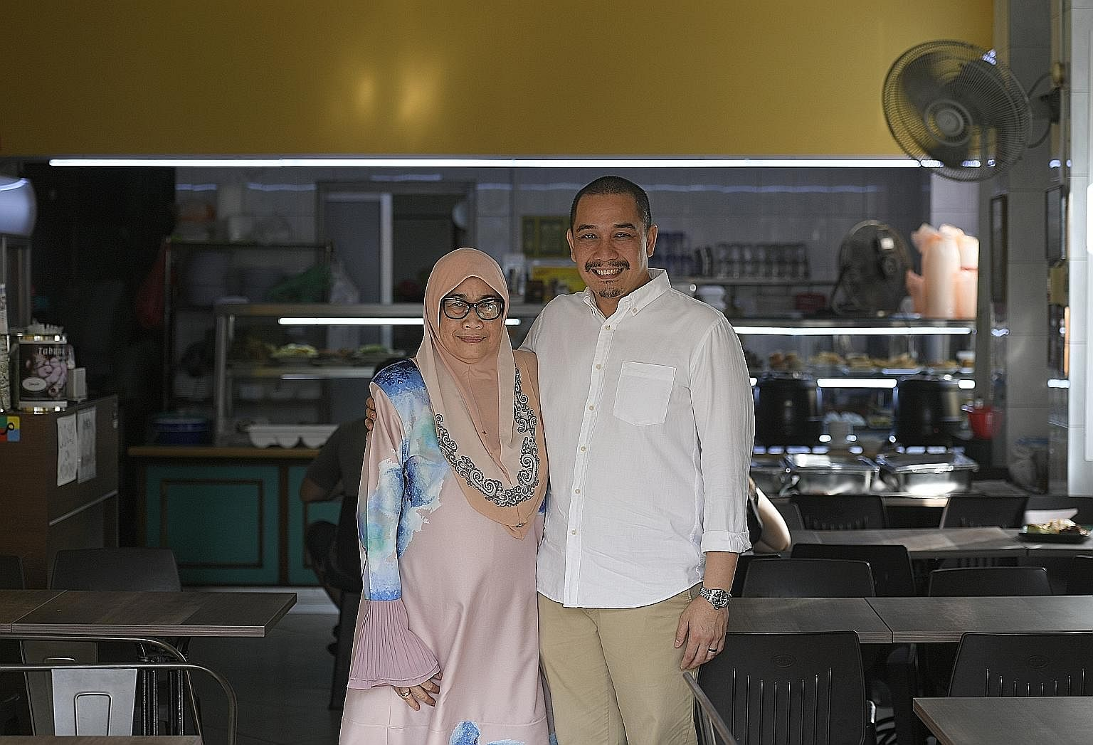 Ms Maryulis Bagindor Marlian (right), who helms Sabar Menanti in North Bridge Road, with her son Iszahar Tambunan, who helps out on Sundays. He is hoping to expand the business.
