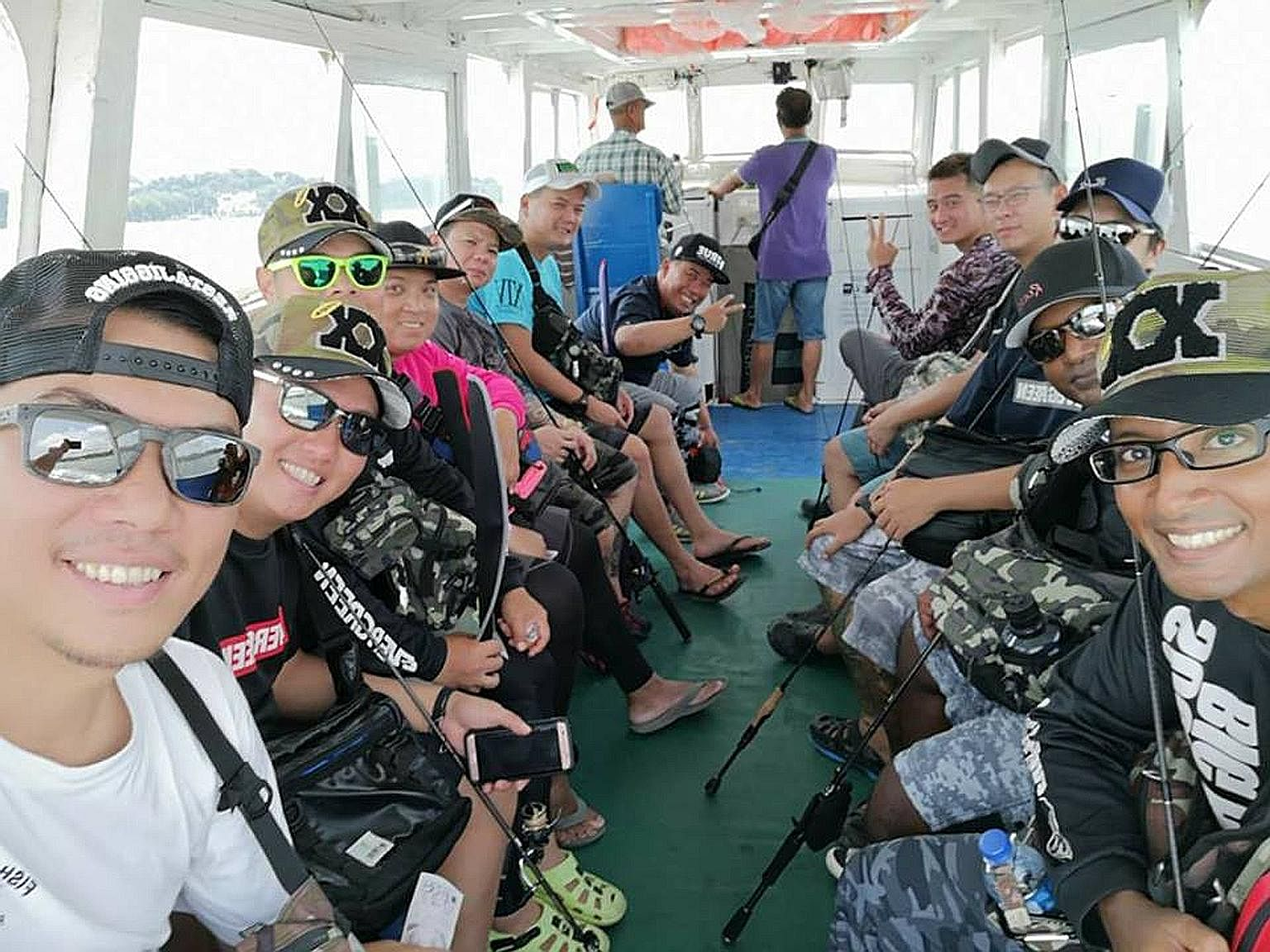 """Mr Billy Tan (above, left) on a fishing trip to Pulau Ubin with his friends. The fishing enthusiast who has been visiting Pulau Ubin once a week in the past four years said he was put off by new fences put up around the island, which once had """"many g"""