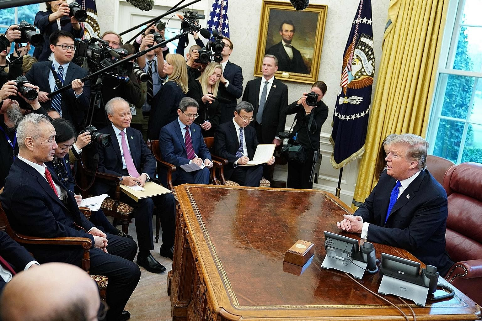 US President Donald Trump in a meeting with China's Vice-Premier Liu He (far left) in the White House's Oval Office on Friday.
