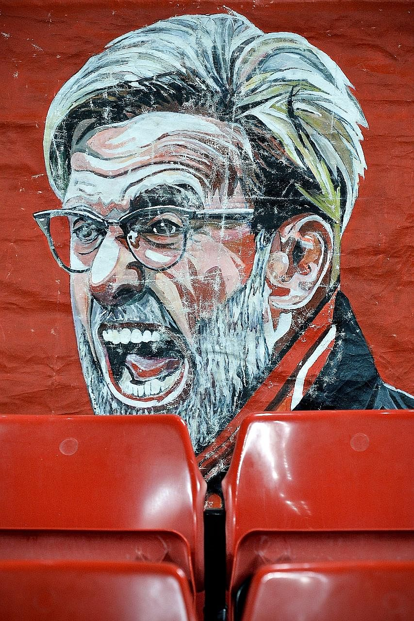 "A banner depicting Jurgen Klopp's likeness at Anfield. The Liverpool manager is looking to tomorrow's Merseyside derby as a ""World Cup final""."