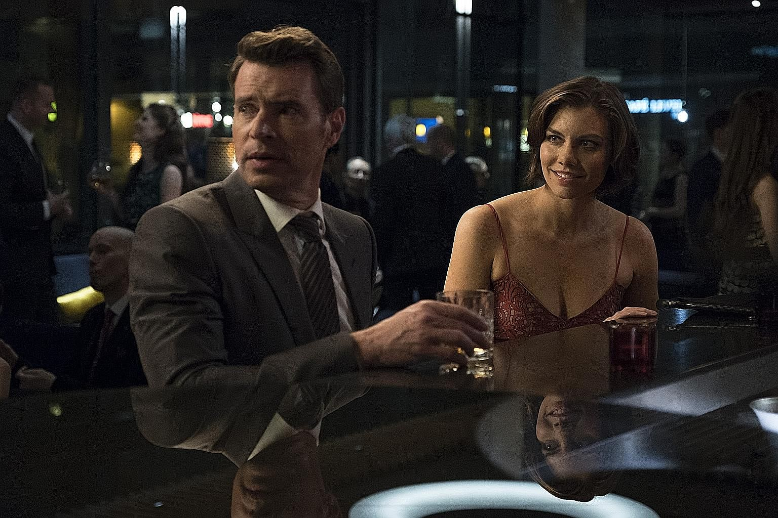 Scott Foley and Lauren Cohan star as rival operatives in spy comedy Whiskey Cavalier.