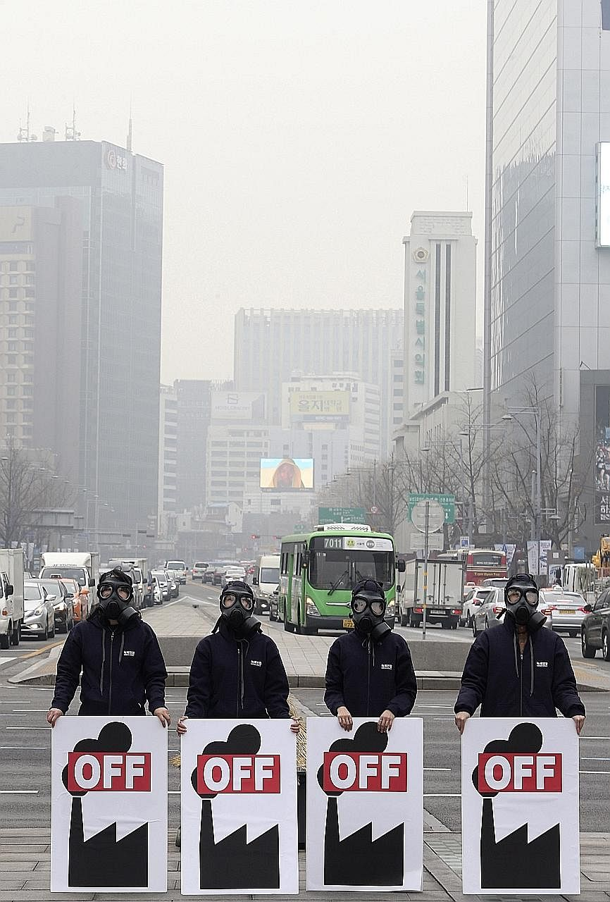 Protesters rallying in Seoul yesterday against the development of a coal mine. Large parts of South Korea are choking on air pollution.