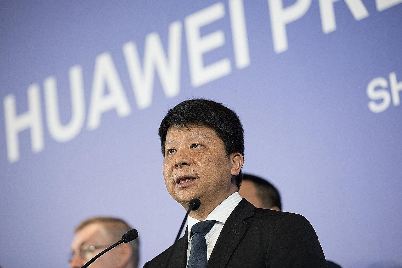 Huawei rotating chairman Guo Ping speaking at a news conference in Shenzhen, in Guangdong province, yesterday.