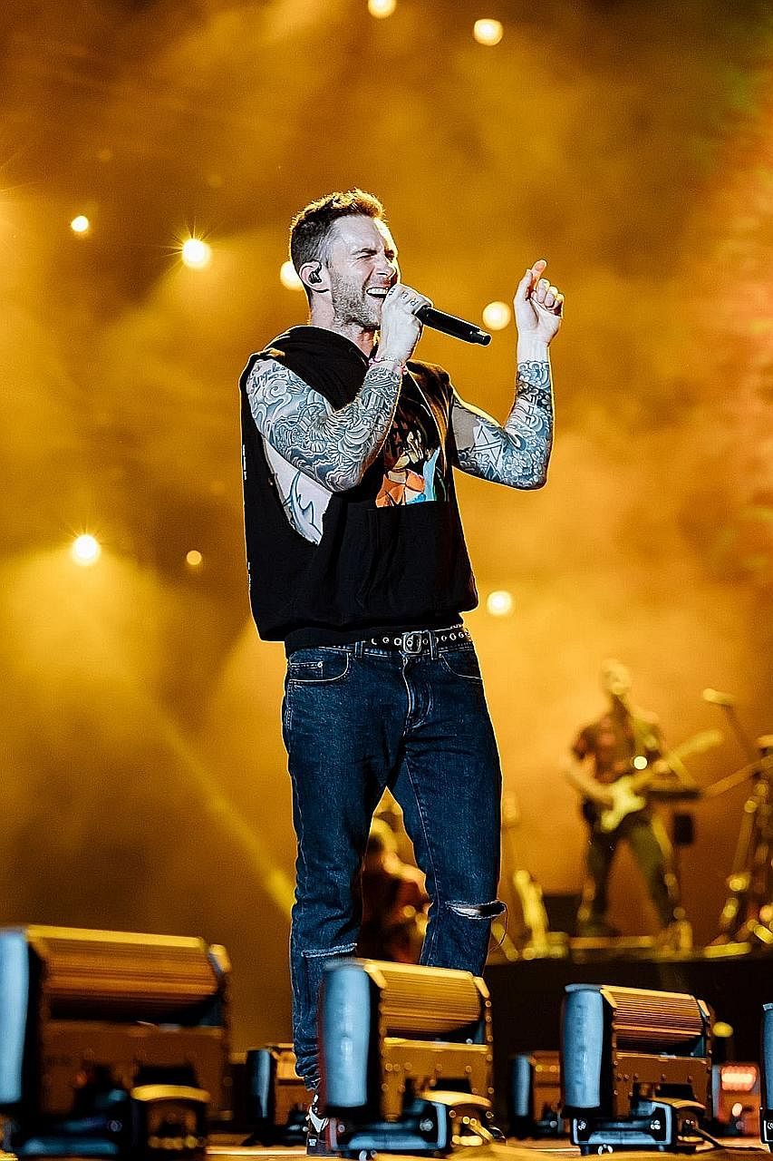 Frontman Adam Levine performing with Maroon 5 as part of the world tour of their sixth and latest album, Red Pill Blues.