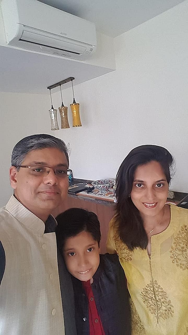 Dr Reyaz M. Singaporewalla with his wife Fatima and son Kaamil. His grandfather, Mr Fazlehusein - who was born here - and Singapore's first president, Mr Yusof Ishak, were schoolmates at Raffles Institution.