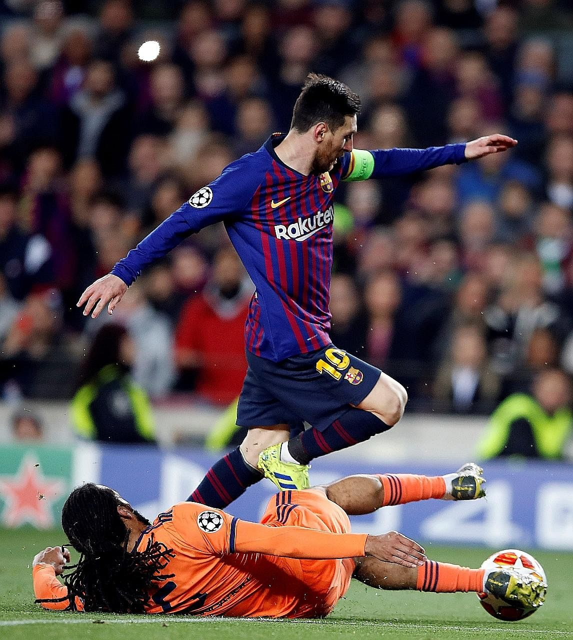 Lionel Messi hurdling one of many challenges from Lyon's Jason Denayer. The Argentina superstar scored twice and had two assists.