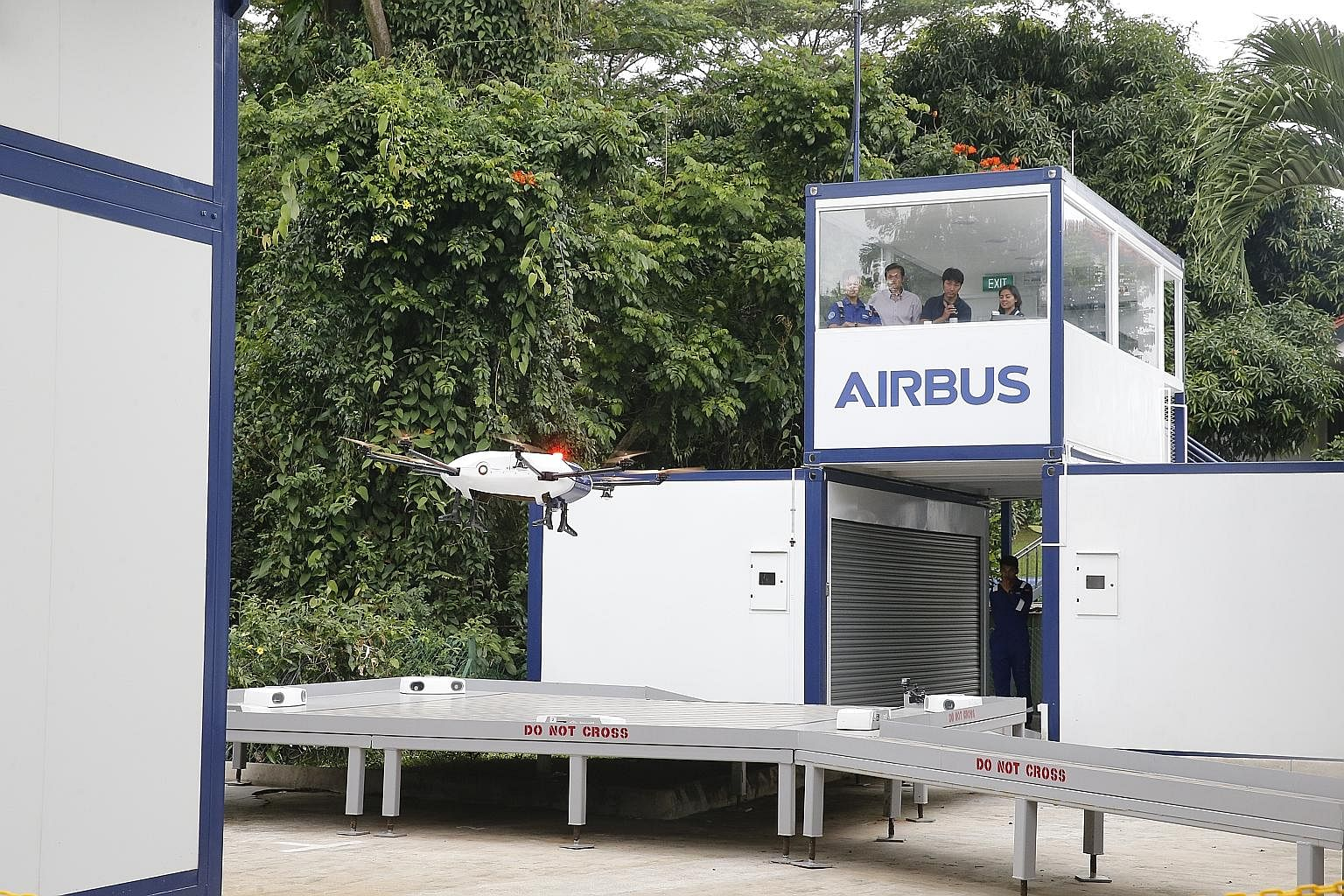 Airbus Helicopters' Skyways unmanned air vehicle completed its first flight demonstration at the National University of Singapore in February last year. (From left) Thales Singapore CEO Kevin Chow, Minister for Trade and Industry Chan Chun Sing, Thal