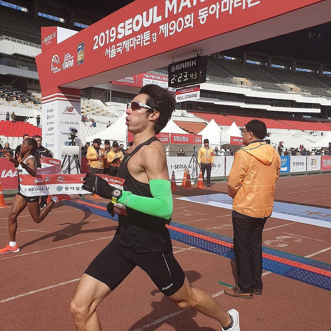 Soh Rui Yong crossing the finishing line in a national mark of 2hr 23min 42sec at the Seoul Marathon yesterday. He now holds the national records in the marathon, the half marathon and the 10,000m.