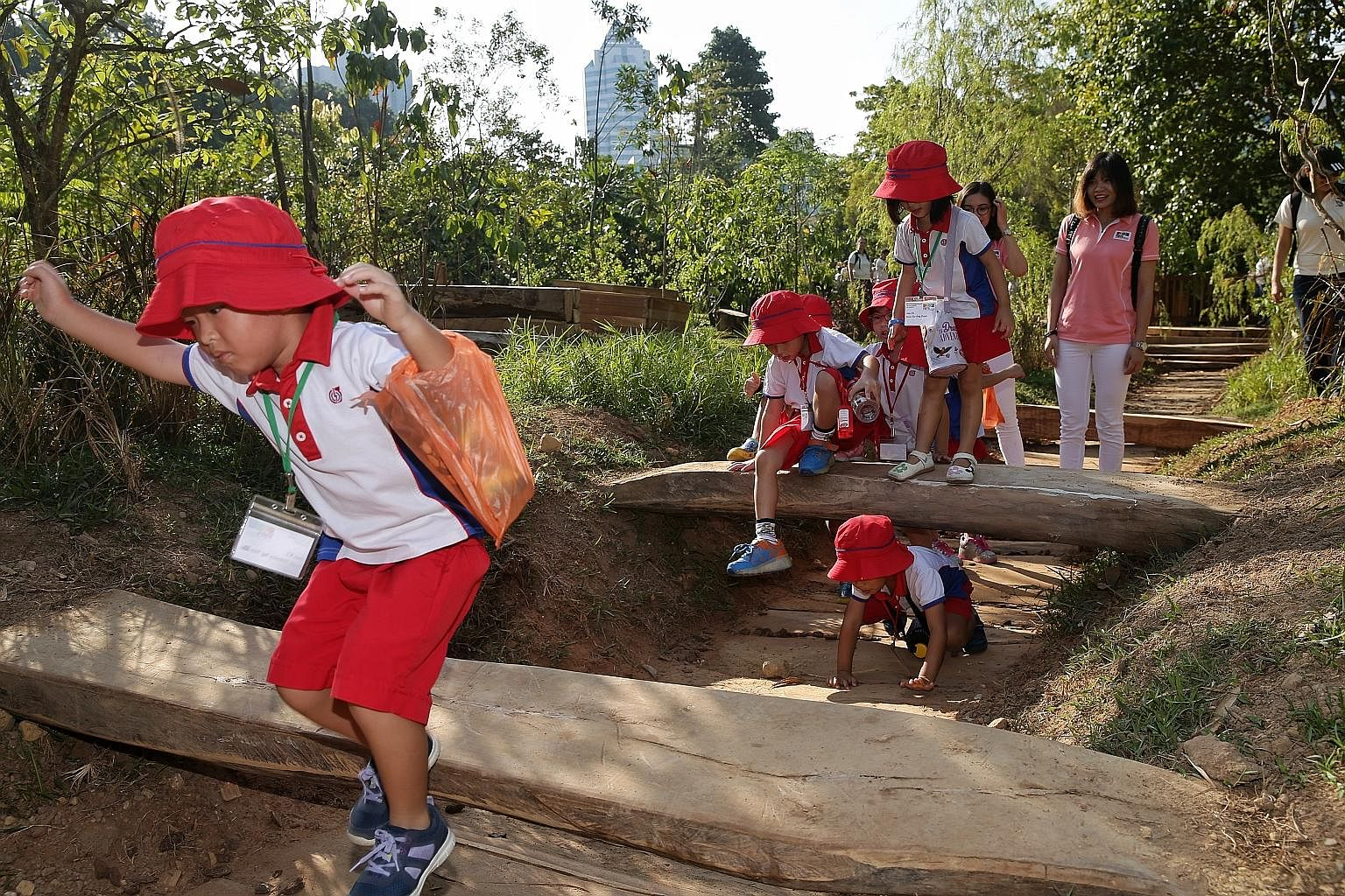 Pre-schoolers from PCF Sparkletots enjoyed a fun day in the sun yesterday at Log Valley, one of the nine different play areas in the National Parks Board's (NParks) new Nature Playgarden at HortPark in Alexandra. Mr Desmond Lee, Minister for Social a