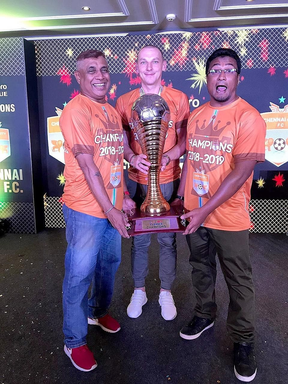 I-League champions Chennai City coach Akbar Nawas, import Jozef Kaplan and assistant coach K. Balagumaran posing with the I-League trophy. Akbar was named Coach of the Year at the I-League awards and trophy presentation ceremony on Wednes