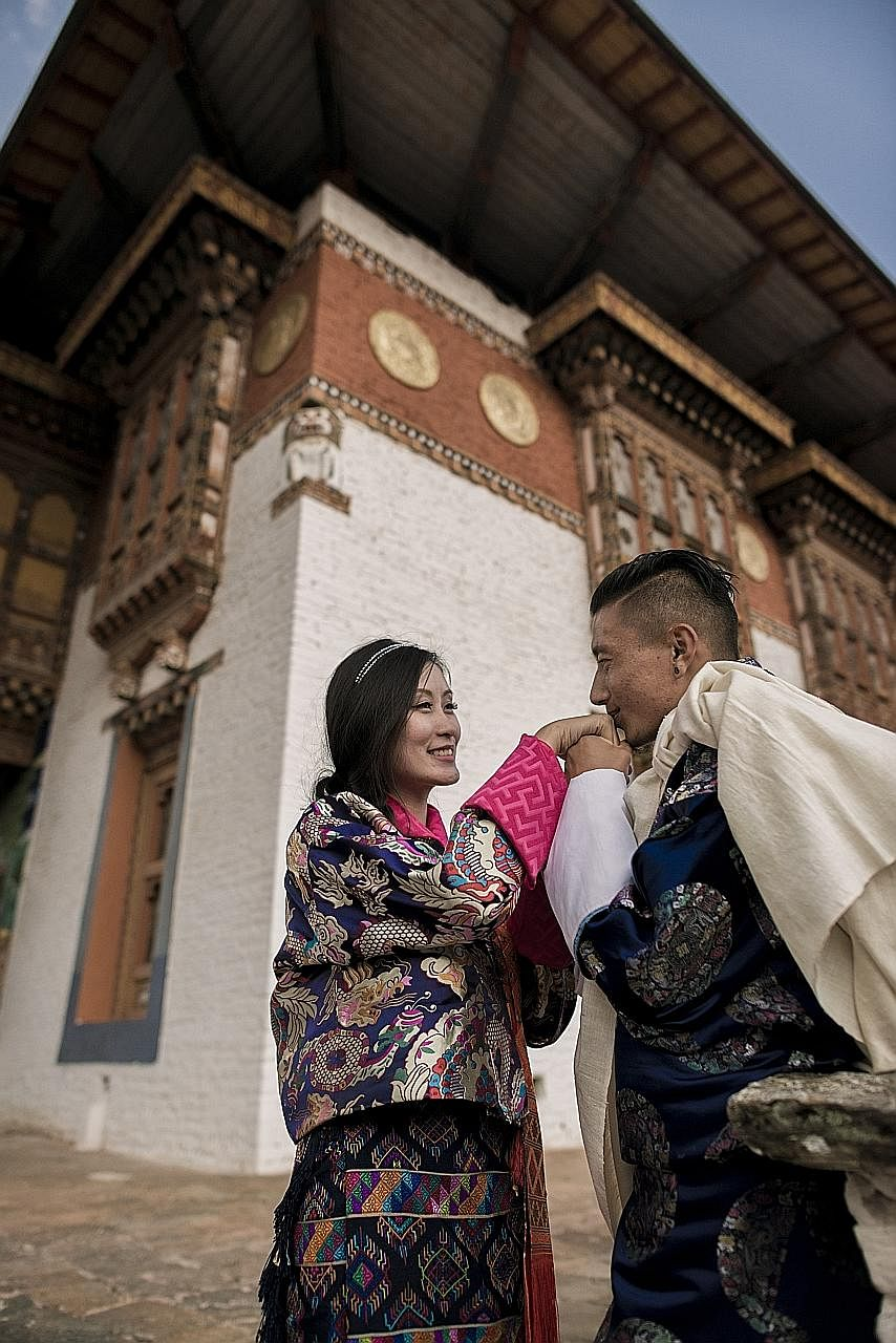 Singapore permanent resident Karen Lim met her Bhutanese husband Ngawang Tshering (both left) during a trip to the country and the couple married last year.