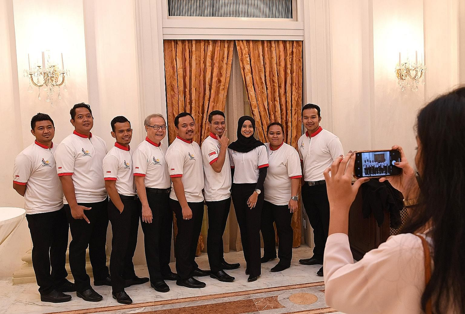 Members of the Singapore silat team posing for a photo at a dinner reception at the Istana yesterday. They were among 209 athletes and officials who were hosted by President Halimah Yacob in recognition of their efforts and achievements at five major