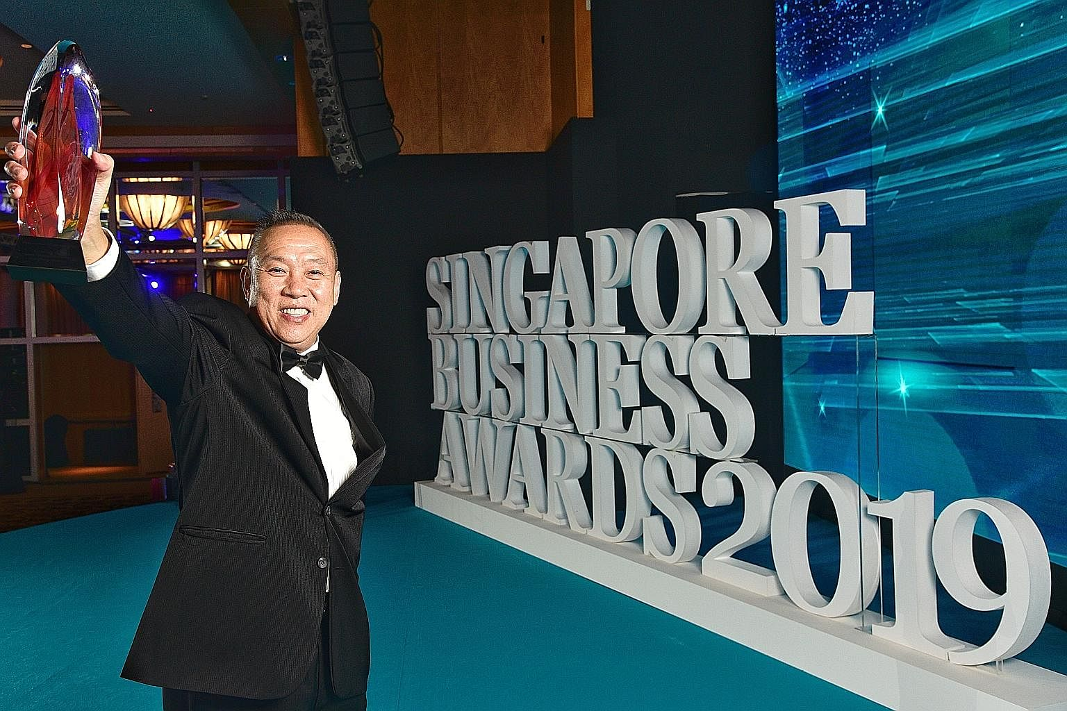 Sheng Siong's founder and chief executive Lim Hock Chee took the top honours at yesterday's Singapore Business Awards (SBA). The 57-year-old was named Businessman of the Year, in a nod to his acumen in growing his company from a modest outfit to the