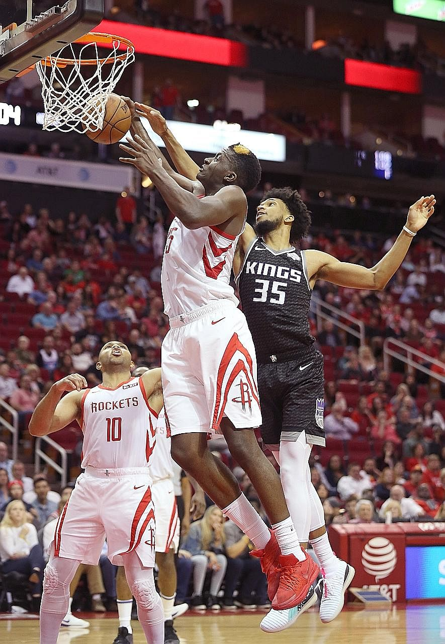 Rockets centre Clint Capela grabs a rebound against Kings forward Marvin Bagley in the game Houston won 119-108.