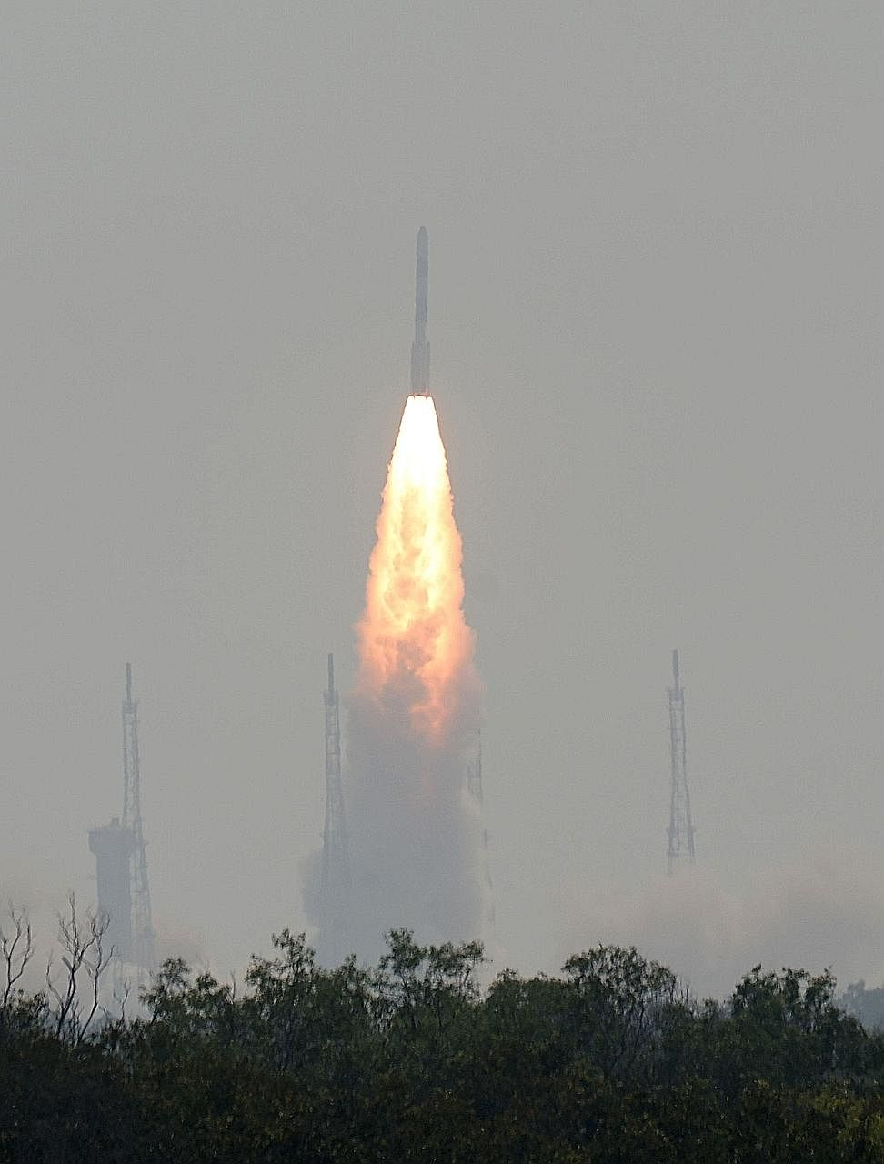 "India's Emisat satellite being launched yesterday. The Indian Space Research Organisation said the ""three-in-one"" launch would help cut costs, and it aims to complete 30 more missions this year."