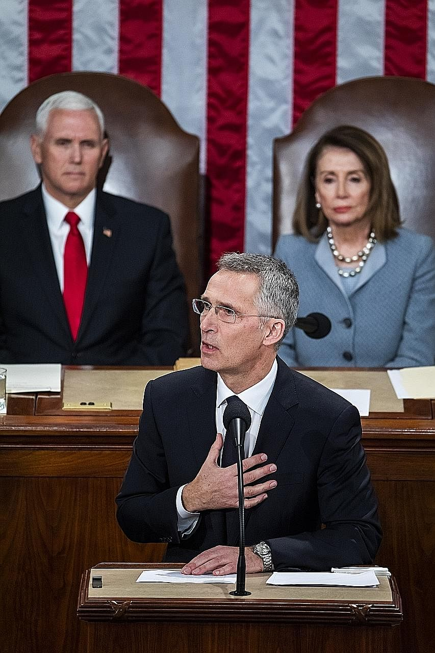Nato secretary-general Jens Stoltenberg addressing the US Congress in Washington on Wednesday, with US Vice-President Mike Pence and House Speaker Nancy Pelosi looking on. Mr Stoltenberg cited how Nato partners came to the aid of the US after the Sep