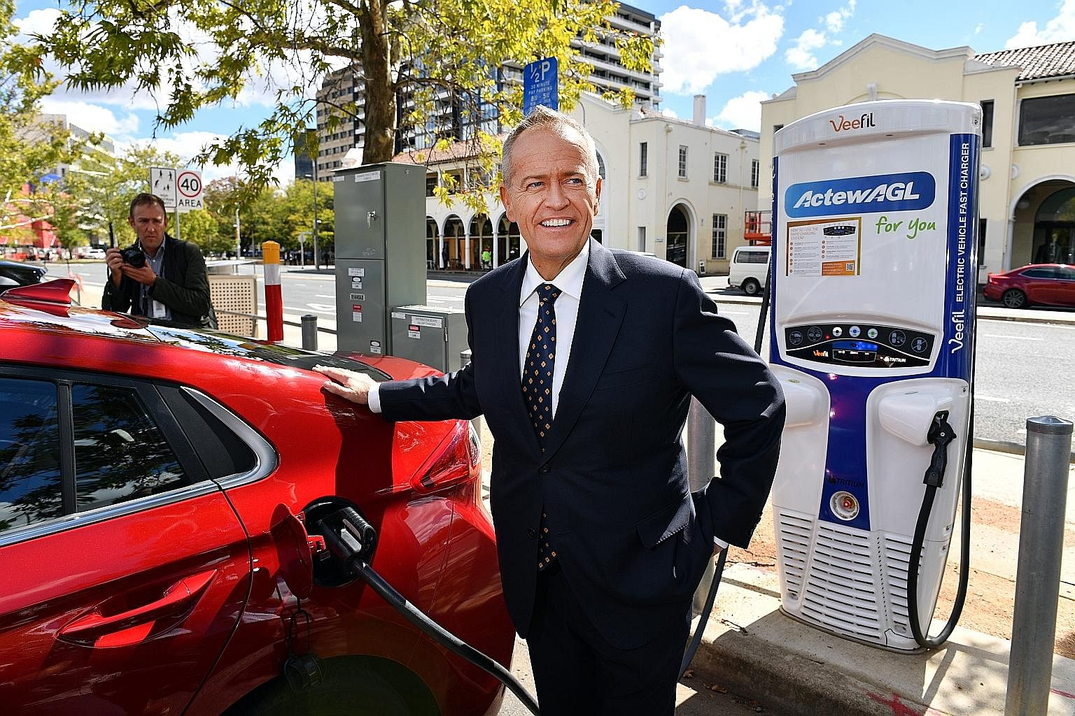 Labor leader Bill Shorten charging an electric car on April 1. The opposition party proposes building 200 fast-charging stations.
