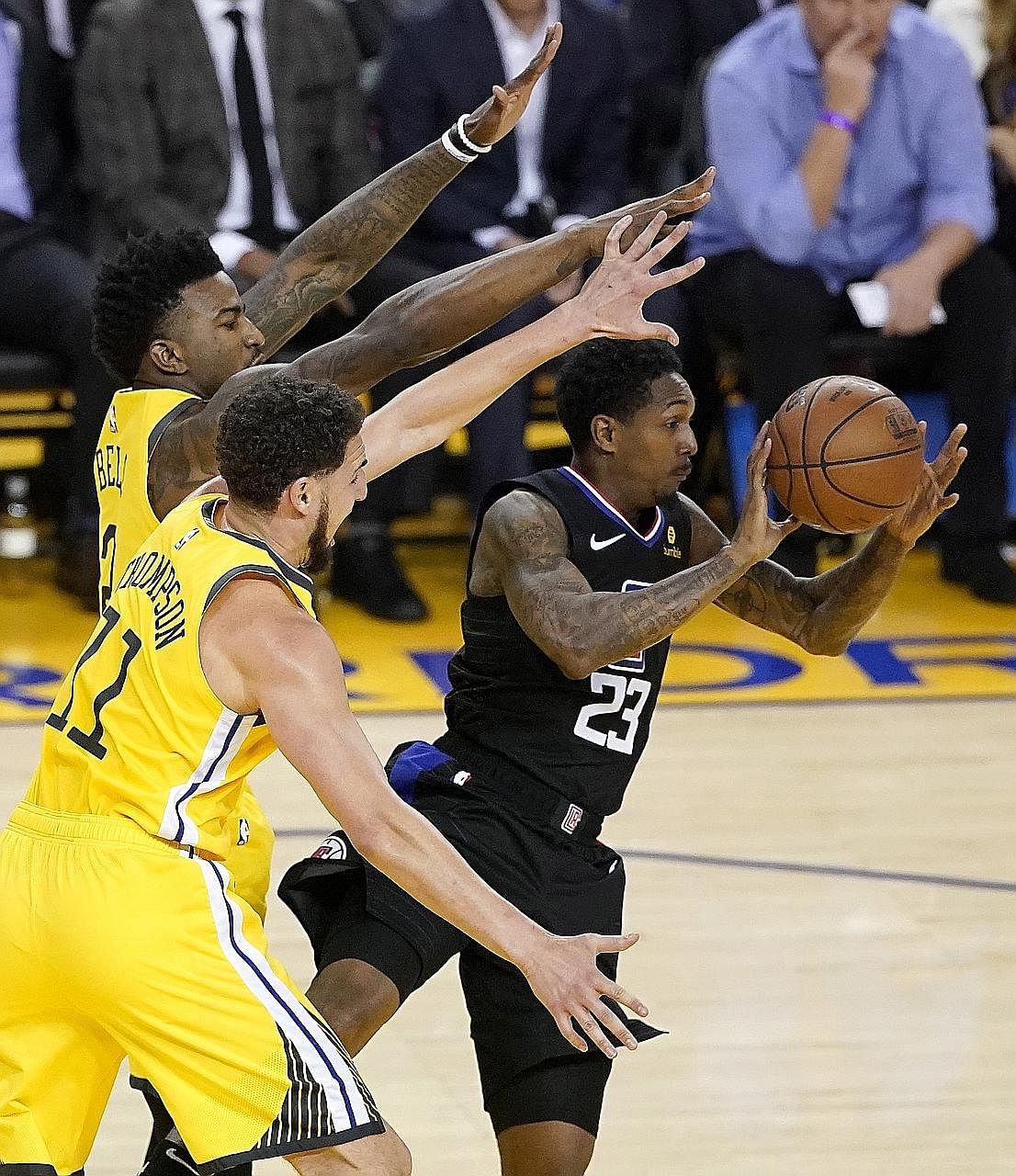 Clippers guard Lou Williams making a pass as Warriors guard Klay Thompson (centre) and forward Jordan Bell defend in Sunday's Game 2 of the NBA Western Conference first-round play-offs in Oakland. The visitors scored 85 points in the second half to b