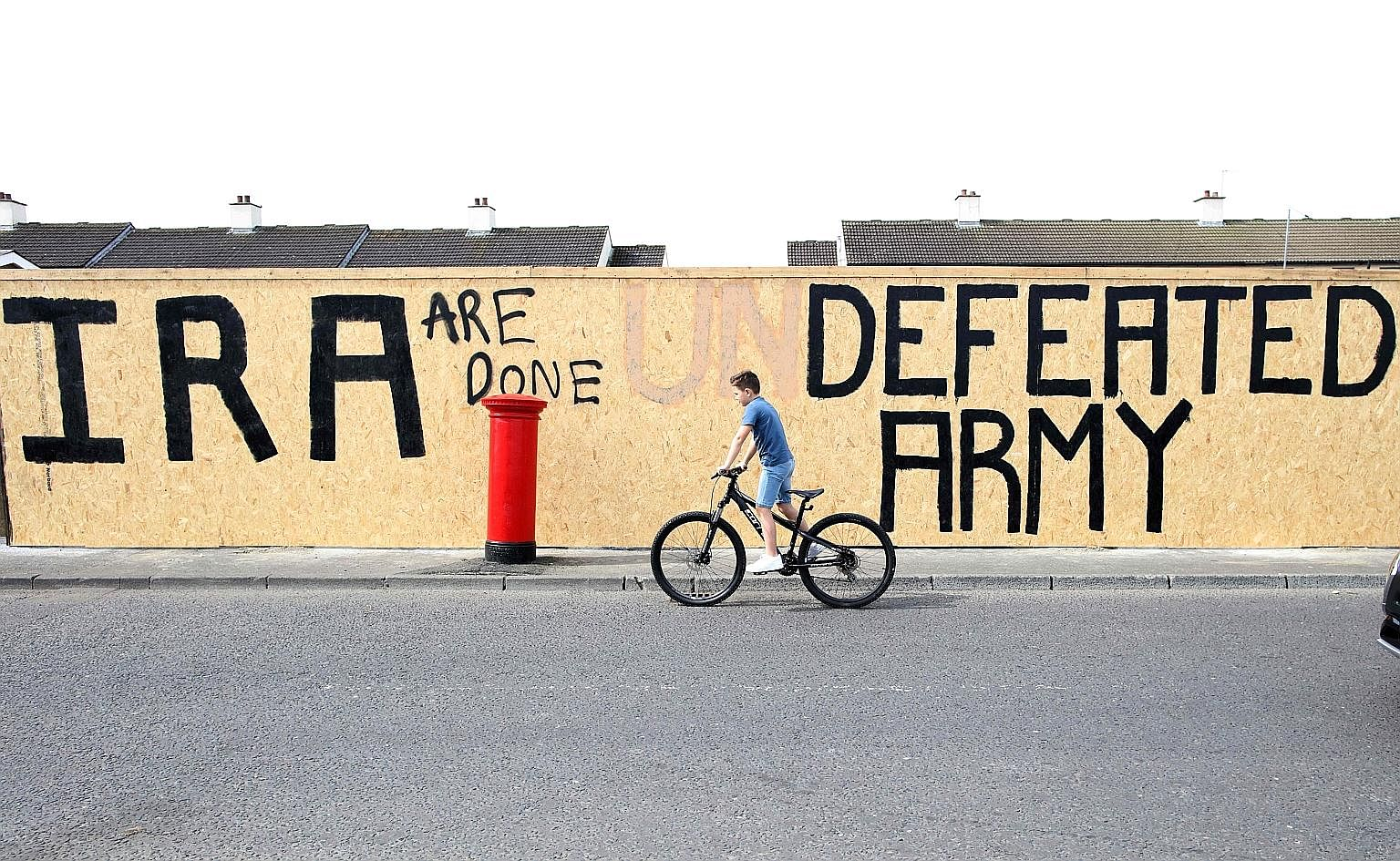 """Graffiti that has been amended to """"IRA are done. Defeated Army"""" instead of """"IRA undefeated Army"""" in Londonderry's Creggan area, near where Ms Lyra McKee was shot last week."""