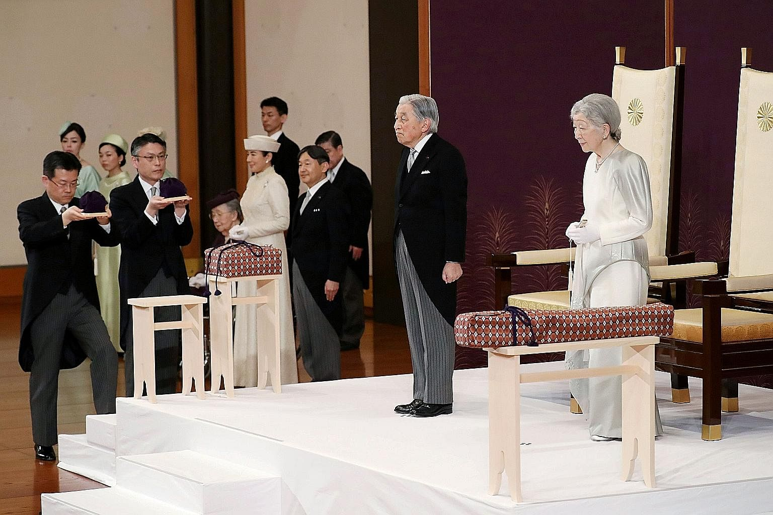 Japan's Emperor Akihito and Empress Michiko, together with Crown Prince Naruhito and Crown Princess Masako, attending the abdication ceremony at the State Room in the Imperial Palace in Tokyo yesterday. Emperor Akihito, 85, in his final remarks as hi