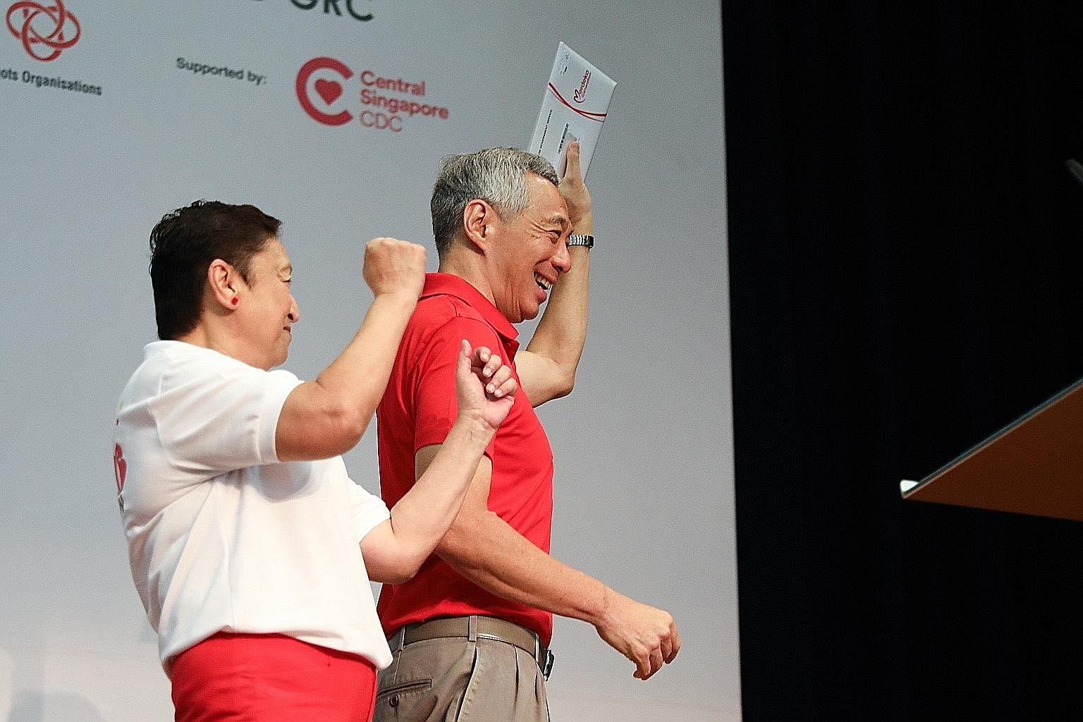 About 8,300 Singaporeans received their Merdeka Generation Package welcome folders yesterday, including Prime Minister Lee Hsien Loong, who was born in 1952. PM Lee received his pack from Madam Noelene De Foe, 66, chairman of the Teck Ghee Community